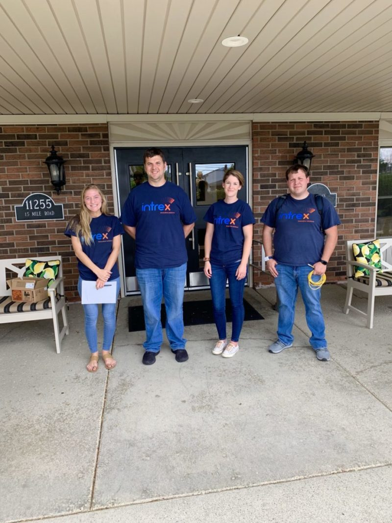 4 Intrex employees outside of a senior living community