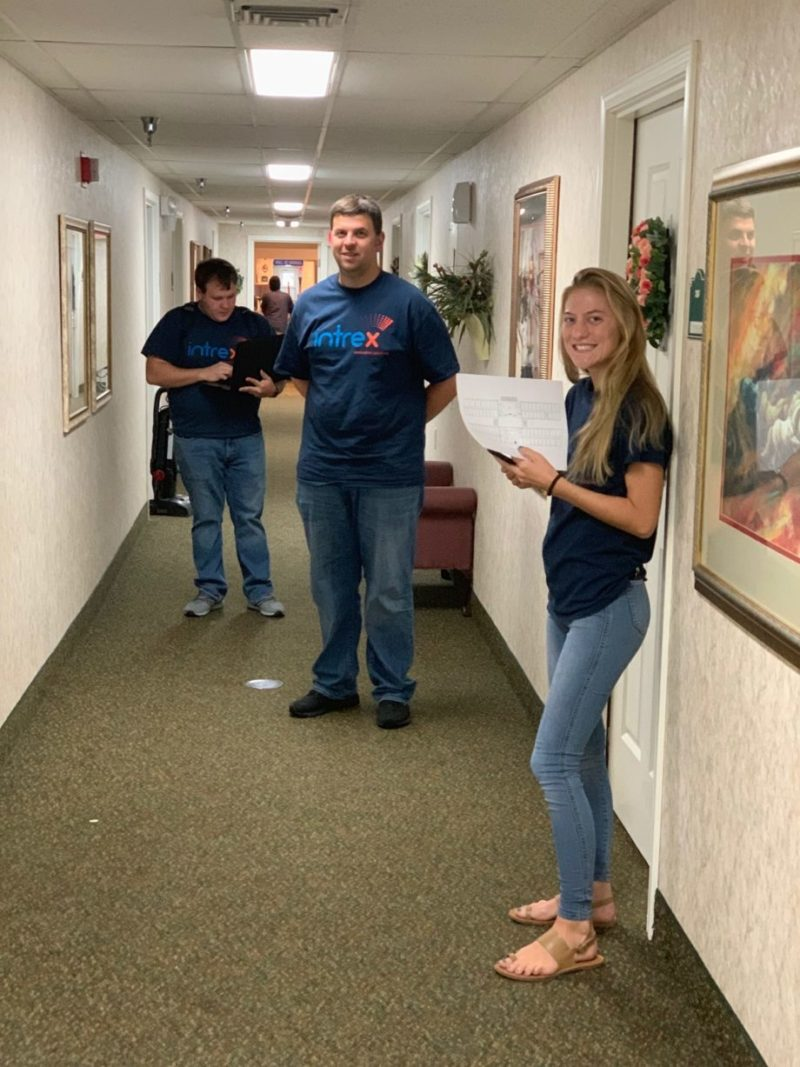 1 male and 1 female Intrex employee smiling at a senior living community