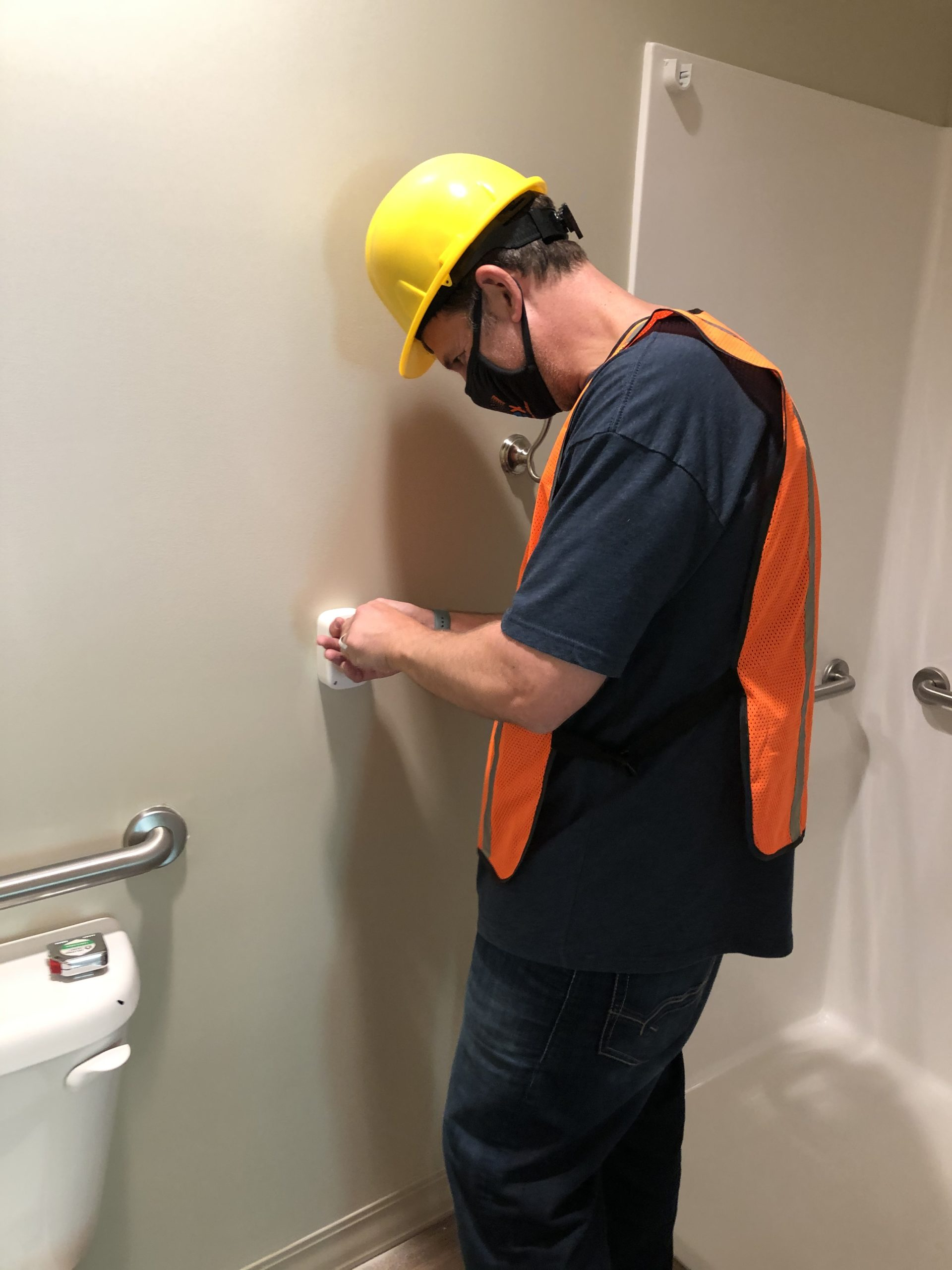 Intrex employee installing a pull cord at a new community